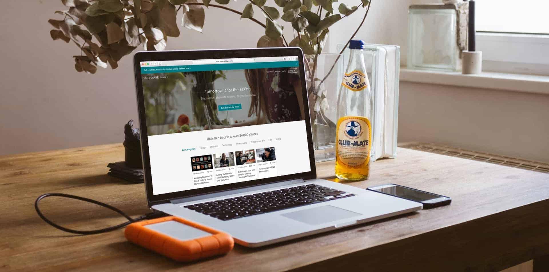 Skillshare site on laptop on wooden desk