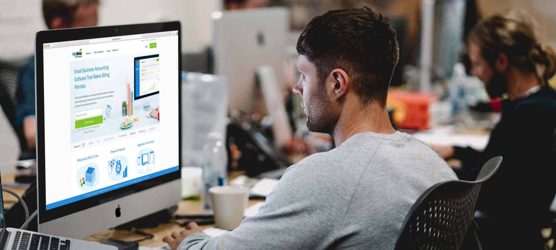 freshbooks on computer with man working